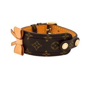 Louis Vuitton Gold tone Monogram Bow bracelet